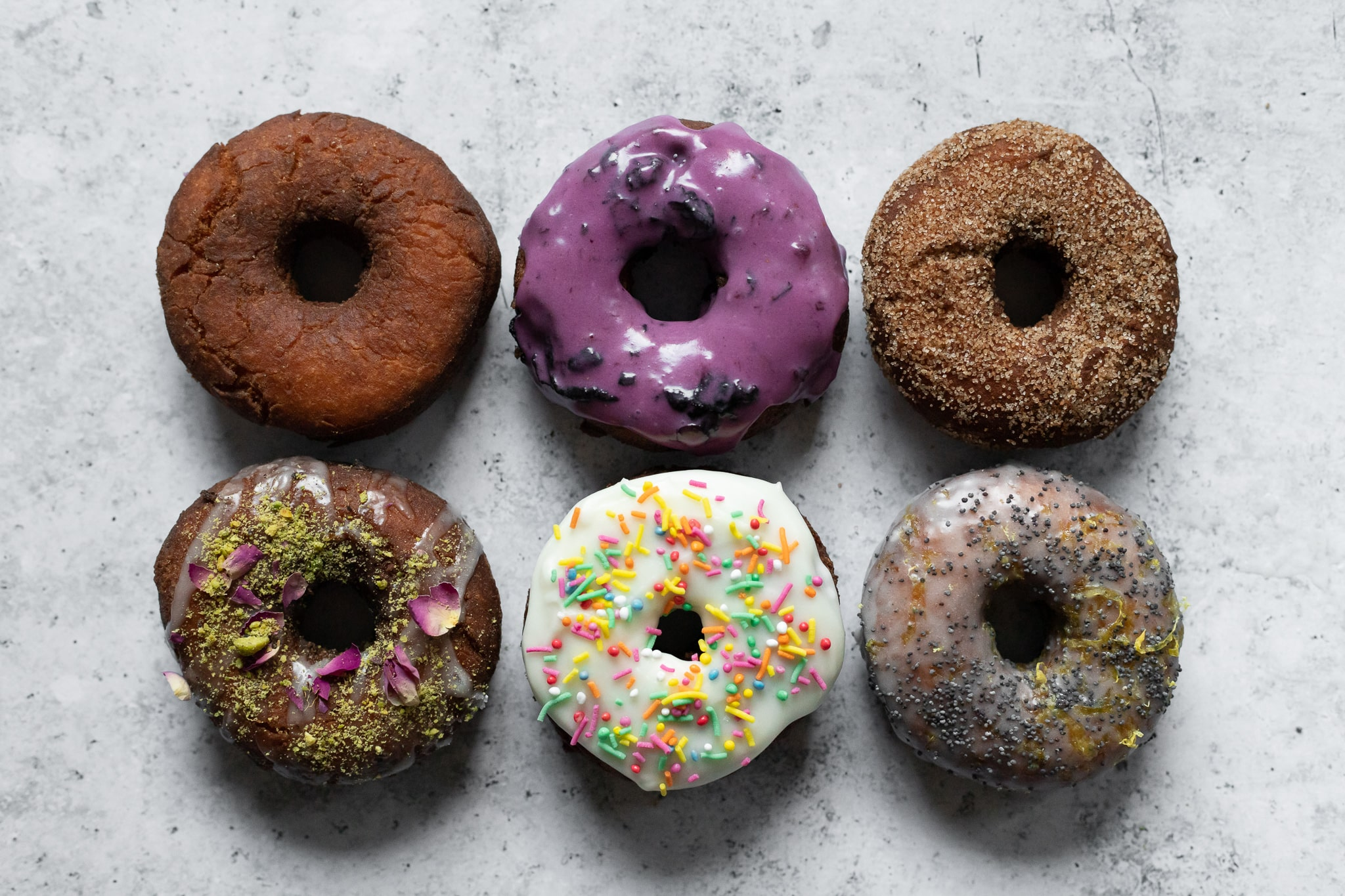 6 colorful donuts photographed from above