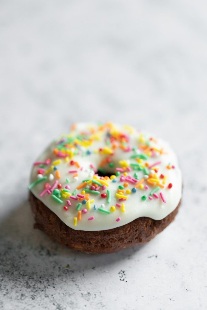 a funfetti old fashioned donut photographed from the side