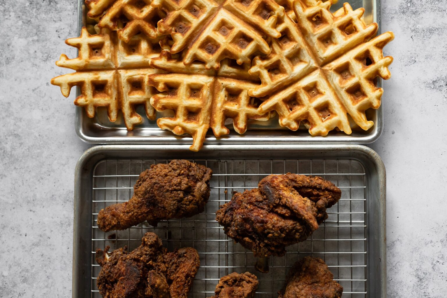 chicken and waffles on separate trays